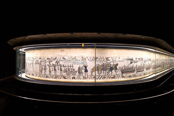 The Bayeux Tapestry in its display case at the Musée de la Tapisserie de Bayeux.