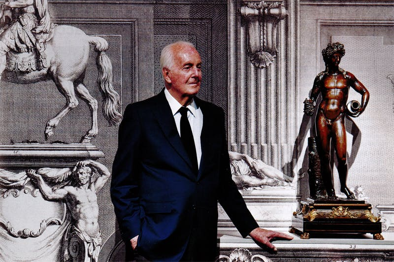 Hubert de Givenchy photographed in September 2012 alongside a figure of Bacchus (c. 1700), attributed to François Girardon.