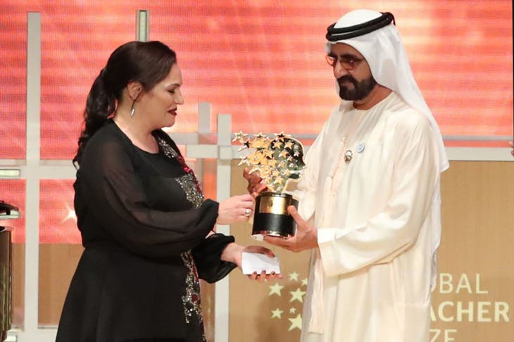 Andria Zafirakou receives the 'Global Teacher Prize' from Sheikh Mohammed bin Rashid al-Maktoum, Vice-President and Prime Minister of the UAE and Ruler of Dubai during an award ceremony in Dubai on 18 March 2018.