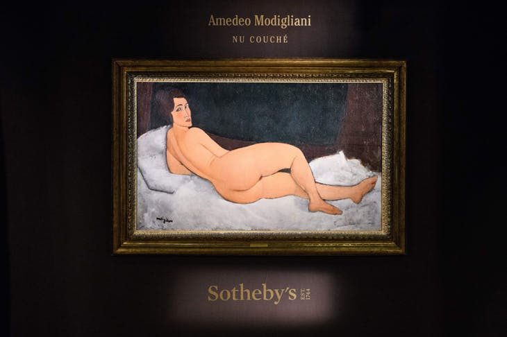 Amedeo Modigliani's 'Nu couché (sur le côté gauche)' painting at the Sotheby's auction house showroom in Hong Kong on 24 April , 2018.