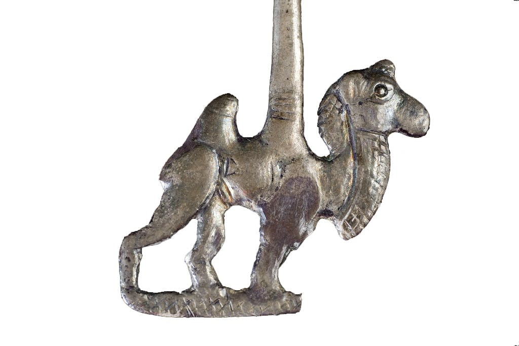 Ornamental needle depicting a Bactrian camel (18–15th century BC), Gonur Depe. Turkmenistan State Museum, Ashgabat.