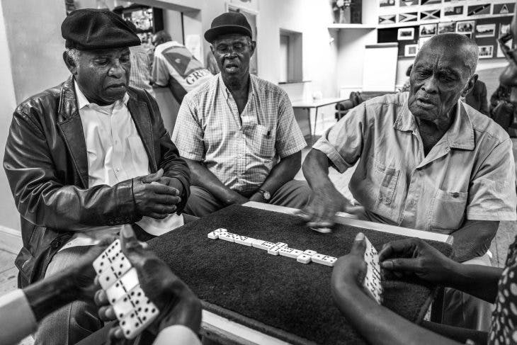Dominoes being played by first generation migrants in a club in Clapham