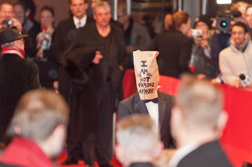 Shia LaBeouf wearing a paper bag on his head at the premiere of the film 'Nymphomaniac (I)'