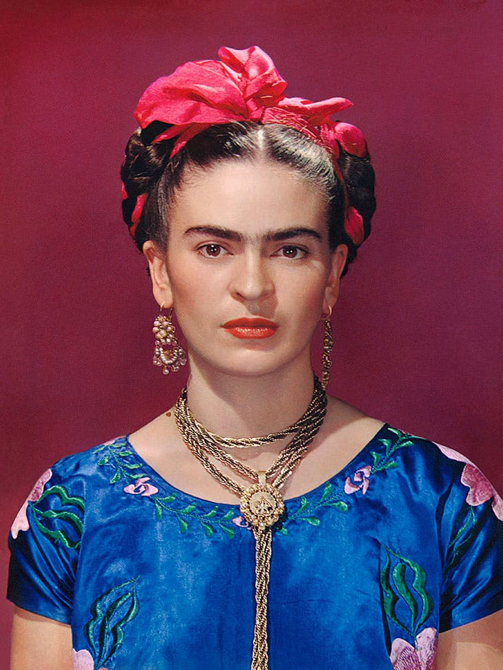Frida Kahlo in blue satin blouse, Nickolas Muray