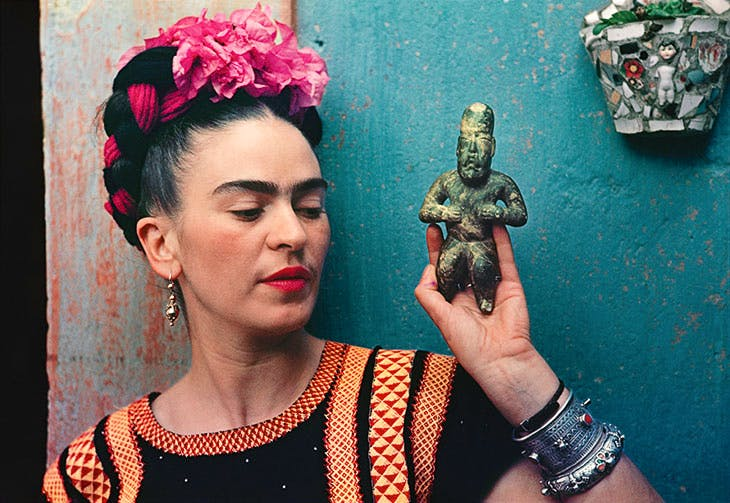 Frida Kahlo with Olmec figurine