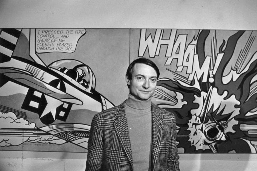 Roy Lichtenstein in front of one of his paintings at the Tate Gallery, London.