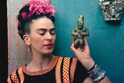 Frida Kahlo with Olmec figurine (1939), Nickolas Muray.