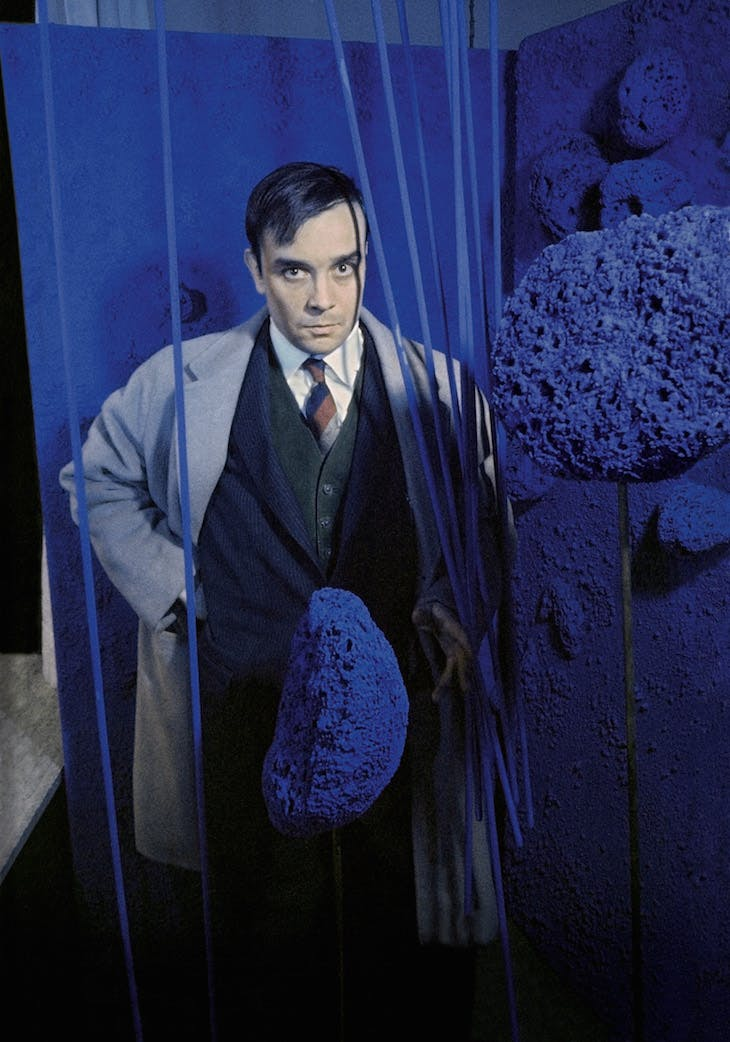 "Yves Klein surrounded by his « Sponge Sculptures » during the opening of the exhibition ""Monochrome und Feuer"""
