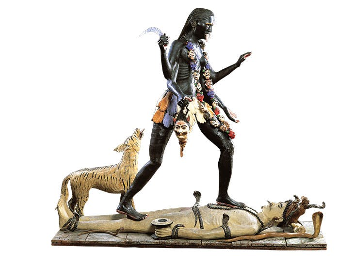 Figure of Kali dancing on Shiva and accompanied by a striped wild animal (c. 1895), Calcutta, India.