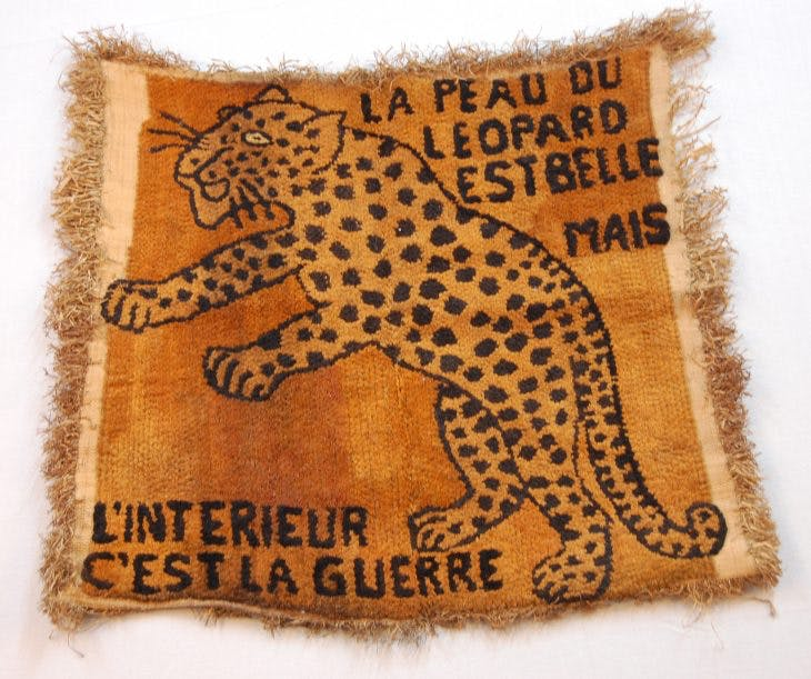 Woven raffia cloth with image of a leaping leopard (1970s–80s), Democratic Republic of Congo.