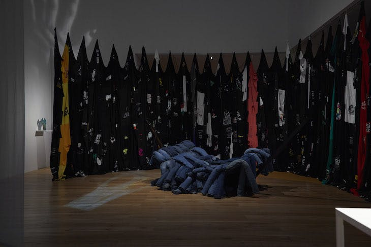 Installation view, Vicky's Blue Jean Hammock 2 (2018) in front of Fade into Black (2017) by Pia Camil, Nottingham Contemporary, 2018.