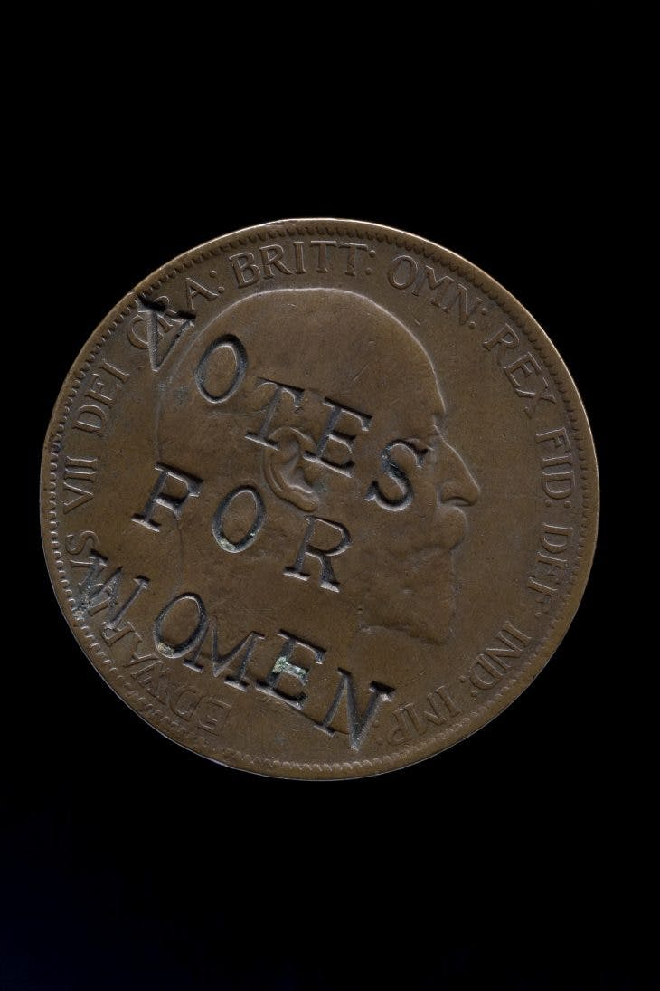 "Edward VII penny, defaced with the slogan ""Votes for Women"" (1903), United Kingdom."