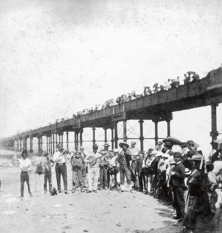 A musical troupe entertaining holidaymakers