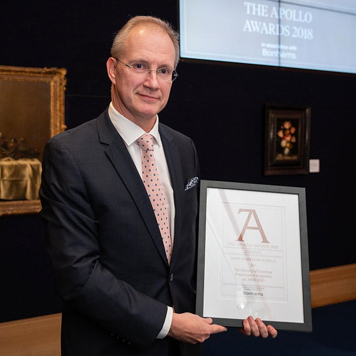 Johan Van der Beke collects the Book of the Year award for 'The History of Venetian Renaissance Sculpture, ca. 1400–1530' by Anne Markham Schulz.