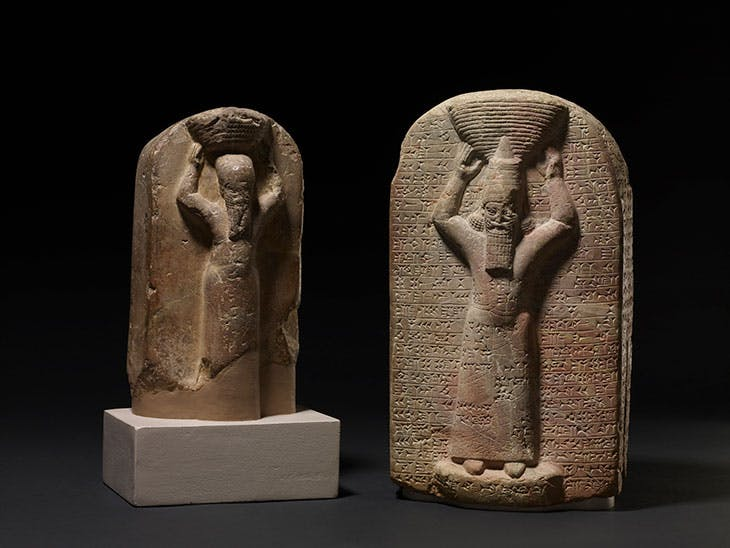 Stone stele depicting Ashurbanipal (right), shown with a ritual basket on his head with cuneiform inscription (668–65 BC), South Iraq, Marduk temple (Babylon). His brother Shamash-shumu-ukin (left) carved with cuneiform inscription (668–55 BC), South Iraq, Temple of Nabu (Borsippa).