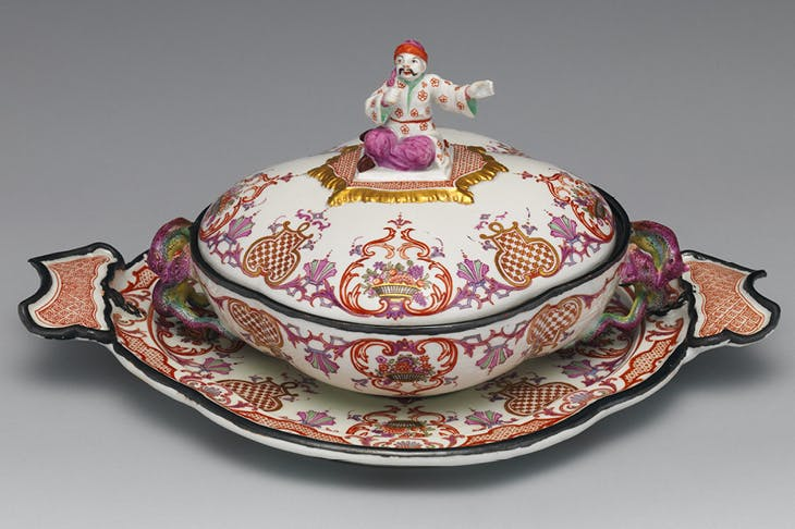 Tureen and cover with a seated Oriental as a knob, and snake handles