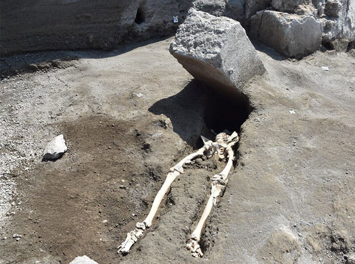 The skeleton of a man crushed by a block of stone, discovered during excavations of Regio V.