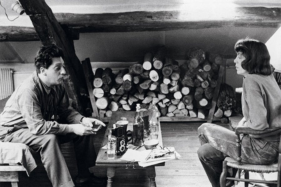 Jean-Paul Riopelle and Joan Mitchell photographed in their apartment-studio on Rue Frémicourt, Paris in 1963.