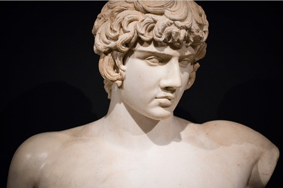 Bust of Antinous with Greek inscription, (AD 130–138), discovered in Balanea, Syria in 1879. Private collection