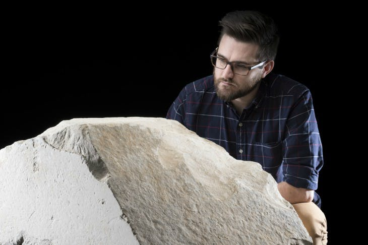 Daniel Potter, assistant curator at National Museum of            Scotland, with a casing stone from the Great Pyramid of Giza.