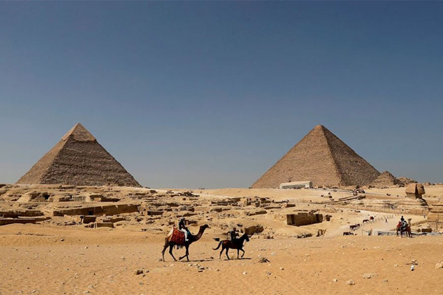The Pyramid of Khafre (left)            and the Great Pyramid of Giza (right), photographed in October            2018.