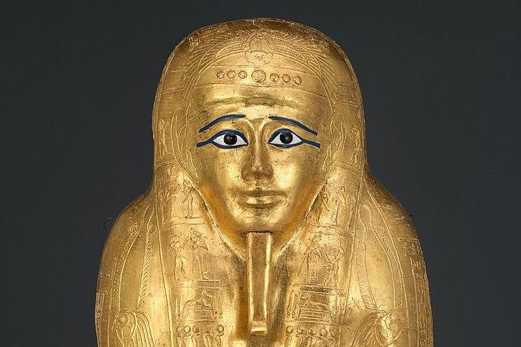 The gilded ancient Egyptian coffin at the Met in New York (detail).