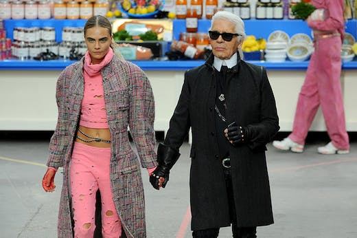 Karl Lagerfeld with Cara Delevingne during the Chanel show at Paris Fashion Week, 2014.