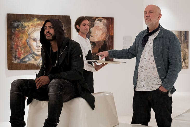 Daveed Diggs and John Malkovich in Velvet Buzzsaw.