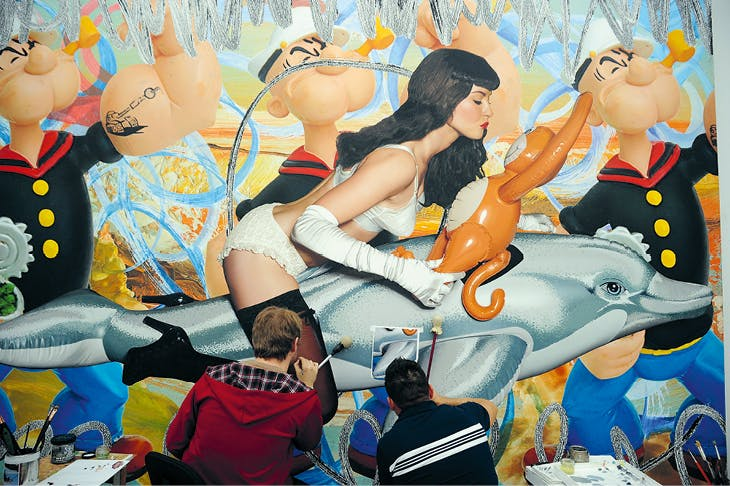 Assistants at work on Girl with Dolphin and Monkey Triple Popeye (Seascape), at Jeff Koons' studio in New York, February 2010.
