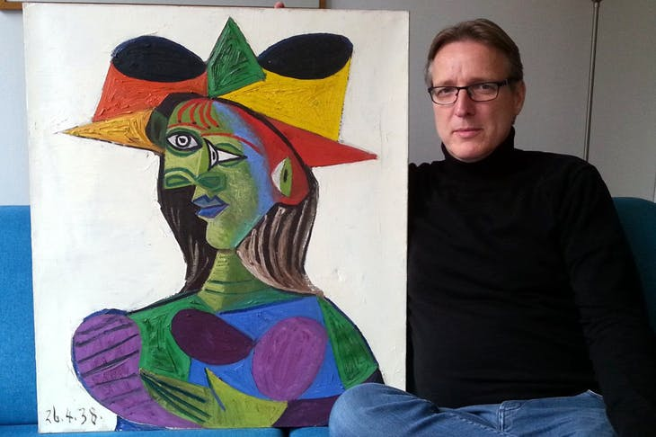 Arthur Brand with the recovered Buste de Femme (1938) by Picasso.