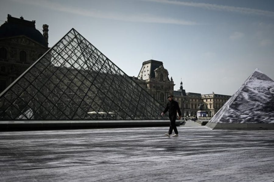 Jean Rene, aka JR walks in the Cour Napoleon of the Louvre Museum as part of the 30th anniversary celebrations of the Louvre Pyramid, Photo: Philippe Lopez/AFP/Getty Images
