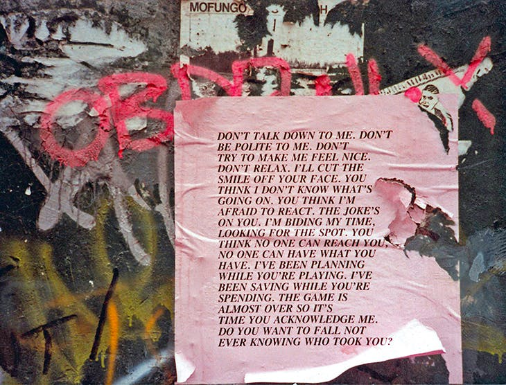 Untitled (Don't Talk Down to Me) from Inflammatory Essays (1979–82), Jenny Holzer, photograph documenting the project in New York in 1983.