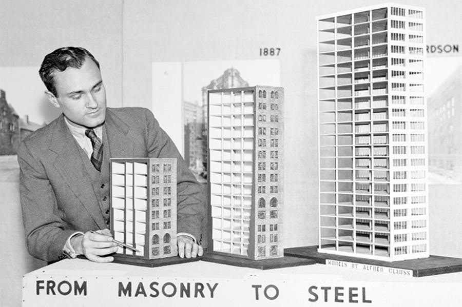 Philip Johnson with models showing 'the evolution of the modern skyscraper', shortly before their display at the Museum of Modern Art, New York, in 1933.
