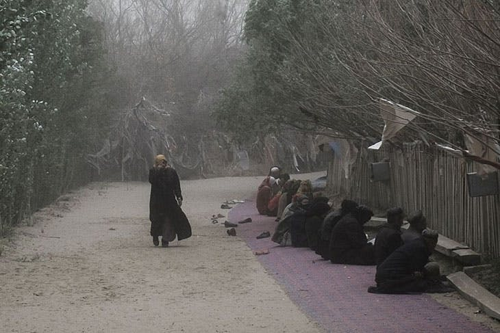 Pilgrims praying at the tomb of Imam Asim in Hotan, Xinjiang, in April 2015. According to a recent report the site has since been demolished.