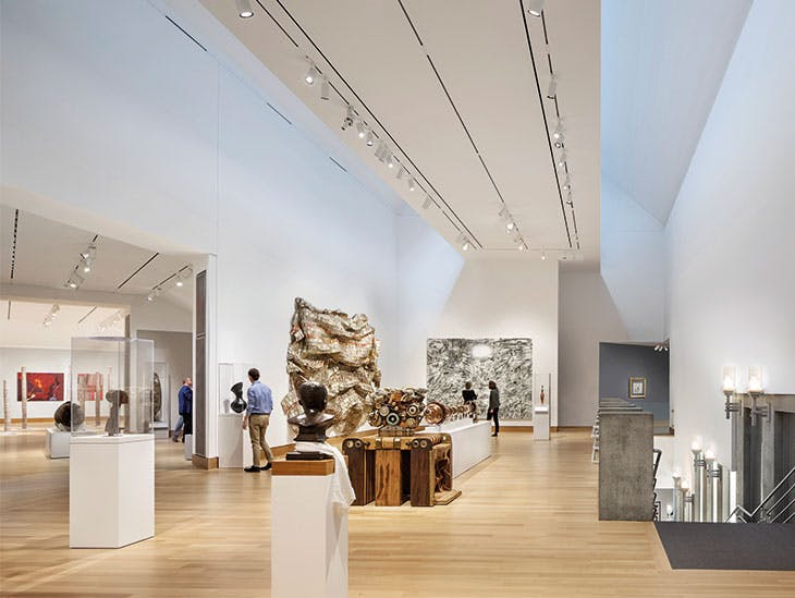 The renovated second-floor galleries feature installations of contemporary Aboriginal Australian art, Melanesian art and contemporary African art – including, on the far wall, Iridium over Aleppo (2018) by Julie Mehretu, and to its left Hovor (2003) by El Anatsui.