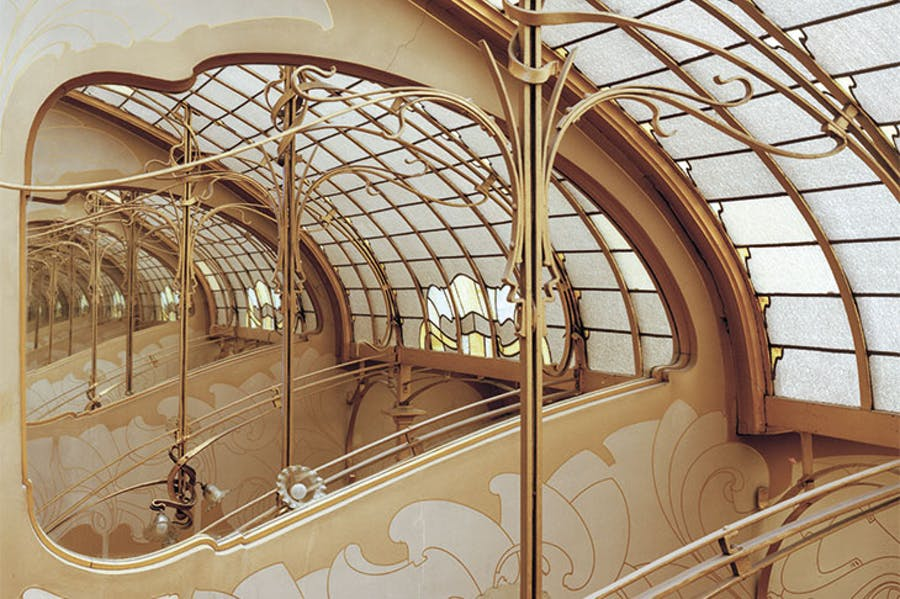 Stained-glass skylight and mirror at the top of the Maison & Atelier Horta.
