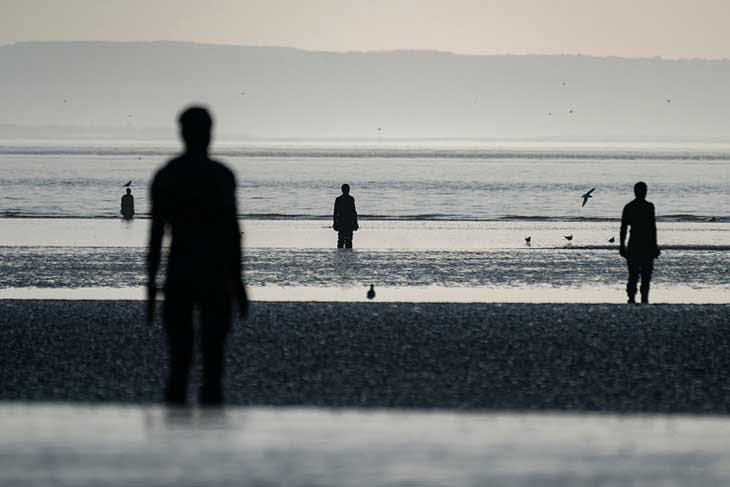 Antony Gormley's ANOTHER PLACE at Crosby beach in 2019.