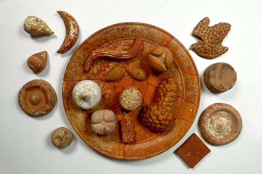 Terracotta votive food: pomegranates (open and closed); grapes; figs; almonds; cheeses; focaccia;