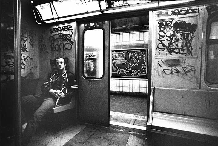 Keith Haring in a subway car in New York (c. 1983), Tseng Kwong Chi.