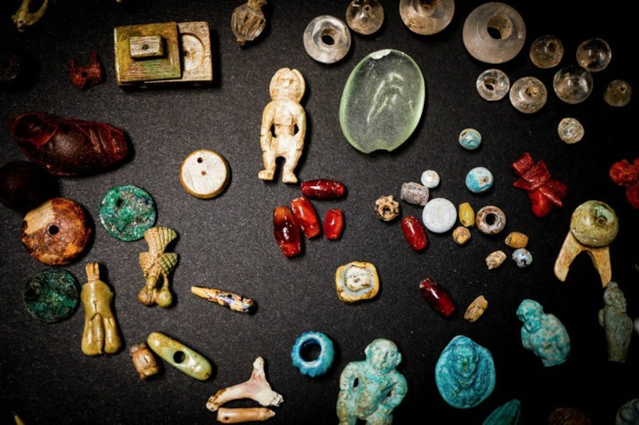 Some of the figurines and gems recently excavated in the House of the Garden at Pompeii.