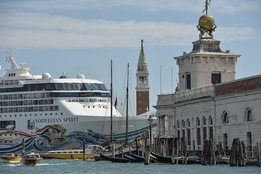 A cruise ship passes close to the church San Giorgio Maggiore, in Venice on 26 September 2014.