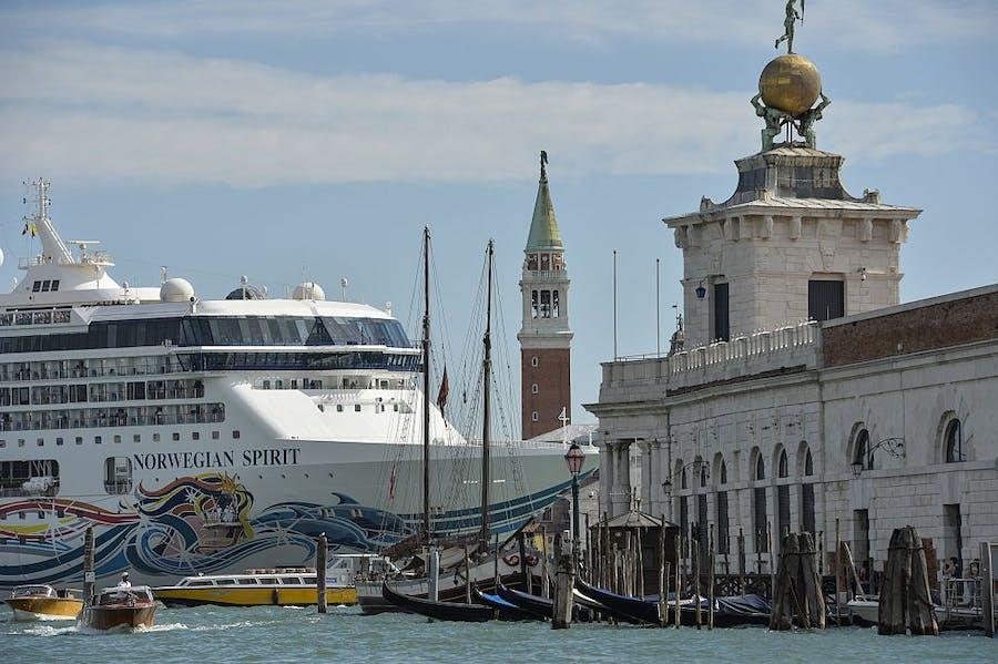 A cruise ship passes close to the church San Giorgio Maggiore, in Venice on 26 September 2014.