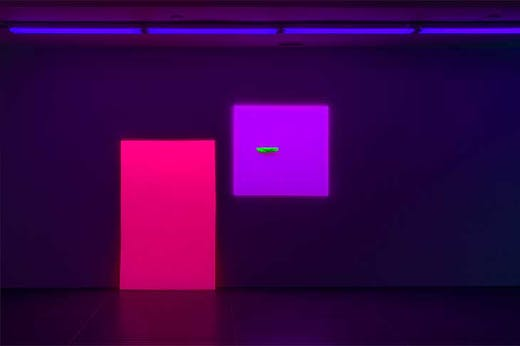 Installation view of 'Jacqueline Humphries' at the Dan Flavin Art Institute, Bridgehampton, New York. On the right hangs Painting (2019).