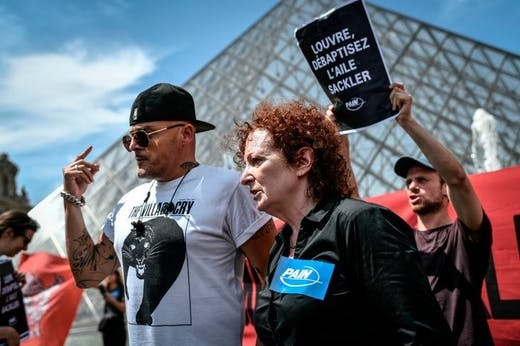 Nan Goldin at a P.A.I.N. protest in front of the Louvre in July 2019.