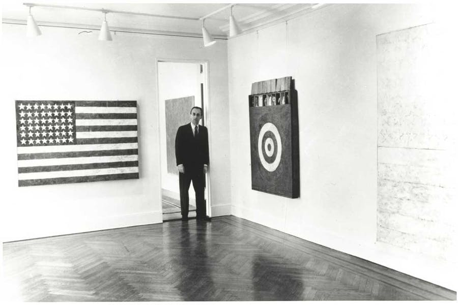 Leo Castelli in a room of the Jasper Johns exhibit at the Castelli Gallery, New York, 1958. Archives of American Art, Smithsonian Institution