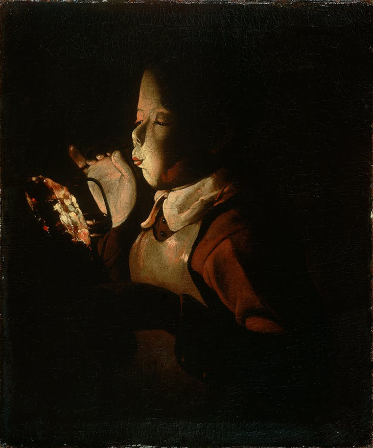 Boy Blowing on Firebrand (c. 1660), Georges de la Tour.