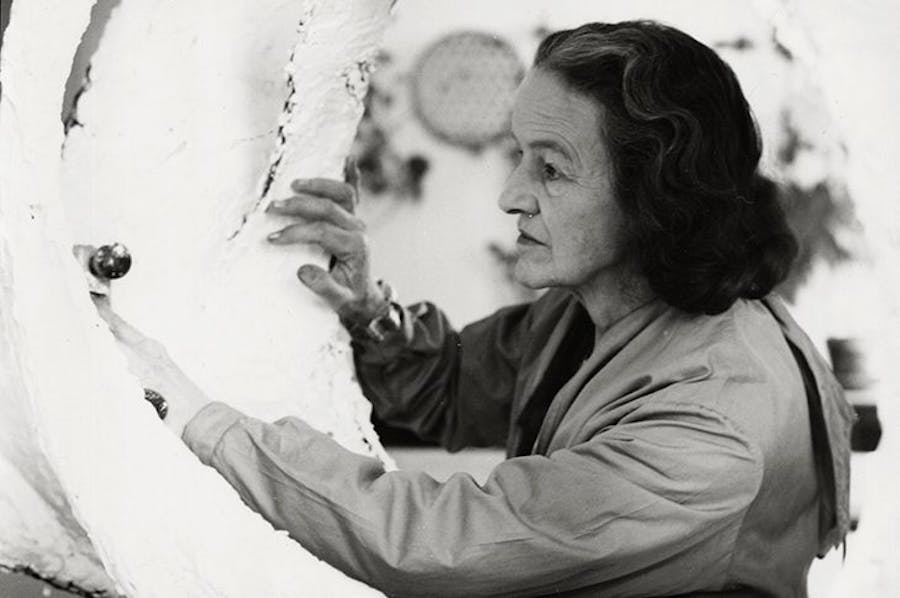Barbara Hepworth working on the plaster Oval Form (Trezion) at the Palais de Danse in 1963.