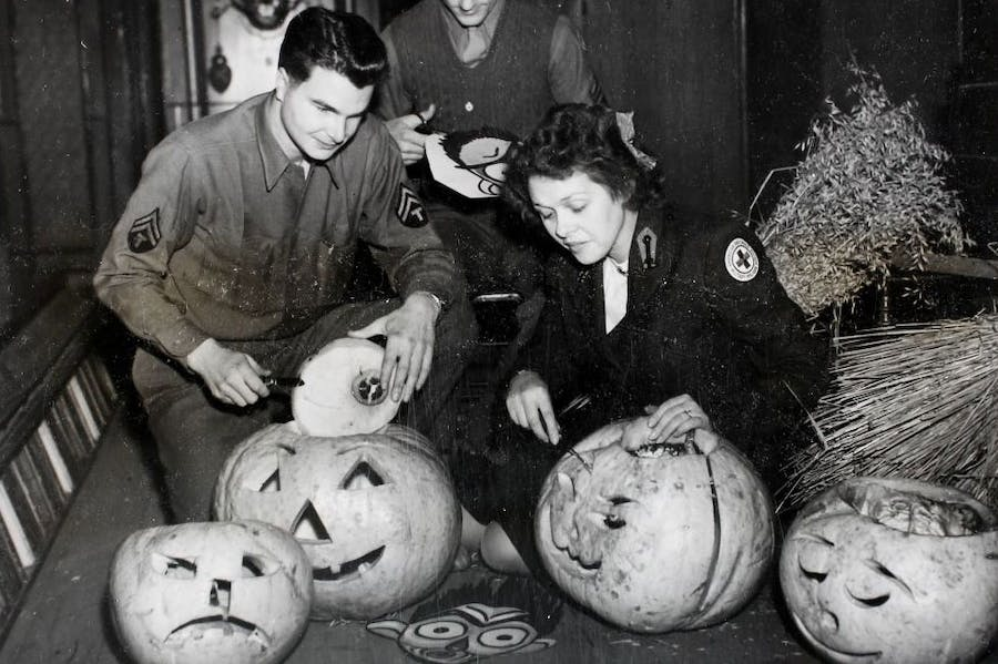 American Red Cross workers hollowing out pumpkins in preparation for a Halloween Dance at Cheltenham Town Hall in 1944.