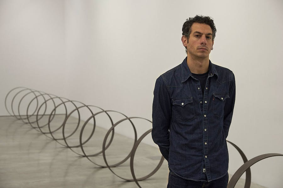 Rayyane Tabet in front of Steel Rings (2013–), from the series The Shortest Distance Between Two Points (2007–).
