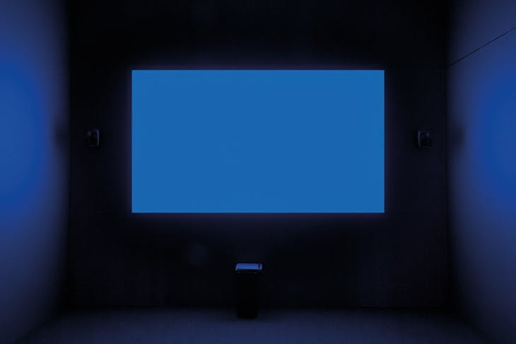 Installation view of Derek Jarman's 'Blue' (1993), first shown at the Venice Biennale in June 1993. Courtesy Tate; © Basilisk Communications